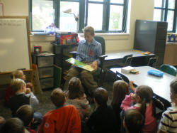 Daniel Hackerman reading to students